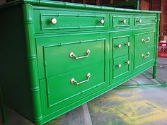 Faux bamboo dresser painted green perhaps?