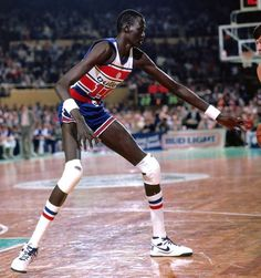 Manute Bol, a 7'7″ Dinka tribesman from the Sudan who was selected by the Washington Bullets 31st overall in the second round of the 1985 NBA draft, defends against the Boston Celtics in a game during his rookie season. (Dick Raphael/NBAE via Getty Images)