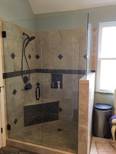 Frameless shower enclosure with a door, notched panel, and return panel, Victorian style handle, in Oil Rubbed Bronze finish Frameless Shower Enclosures, Bronze Finish, Victorian Fashion, Showers, Art Pieces, Sink, Bathtub, Handle, Bathroom