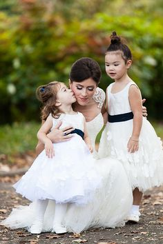 Adorable flower girls in white dresses | @anthonyvazquez | Brides.com