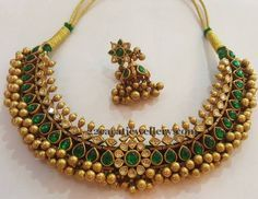 Gold solid balls embellished tussi necklace with polki diamonds and pear shaped pota emeralds. Huge jhumkas paired up with the set from S. Kids Gold Jewellery, Gold Jewelry Simple, Indian Jewellery Design, Latest Jewellery, Temple Jewellery, Indian Jewelry, Jewelry Design, Designer Jewellery, Traditional Indian Jewellery