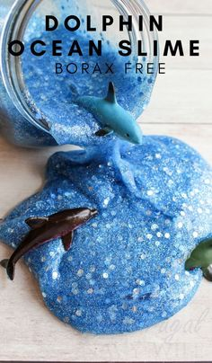 We made this Ocean Slime at the request of my son and they had a blast with it! Borax Free so it's totally safe for the kids. #slime #dolphins #oceanslime #homeschool #frugalnavywife | Slime Recipes | Homeschooling Activities | Dolphins Themed Activities | Ocean Themed Activities via @frugalnavywife