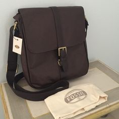 "Fossil Estate City Bag Brand new, with tags. Dust bag included. 100% dark brown leather. approx. 10.25 x 3 x 11"". Cotton twill lining. Adjustable shoulder strap. 1 padded slip pocket; zipper pocket; 2 slip pockets; 3 pen holder; 1 credit card slot 1 outer slip pocket pushlock closure vintage brass hardware Fossil Bags Crossbody Bags"
