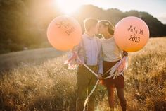 Giant balloons with fabric tassels.