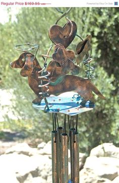 DACHSHUND Pet Memorial WIND CHIME Copper Metal Outdoor Garden Yard Art Dog Ornament Patio Decor Patina Finish on Etsy, $139.00. Again would use for yard decoration, not a memorial. So cute!