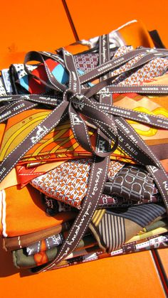 There's not a brand that will embody Paris to you more than Hermès, and nothing is more Parisian than a scarf. More Parisian brands and gift ideas at Grabr. Turbans, Scarf Packaging, Paris Gifts, Hermes Orange, Titanium Wedding Rings, Cowgirl Bling, Hermes Bags, Silk Scarves, Hermes Scarves