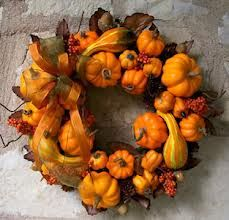 You will need: Dried gourds, assorted dried fall flowers and leaves, a grapevine wreath (size of your choosing), floral wire and possibly hot glue.  I find it easiest to start with the focal point of my wreath and work from their; attaching dried gourds, etc. with floral wire by gently piercing each piece and running the wire through to the back of the wreath. Cut off excess bits of wire in back after twisting to secure. Use hot glue as needed for heavier pieces that droop.