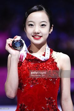Marin Honda of Japan and bronze medal poses during the Junior Ladies medals ceremony during day three of the ISU Grand Prix of Figure Skating Final 2015/2016 at the Barcelona International Convention Centre on December 12, 2015 in Barcelona, Spain.