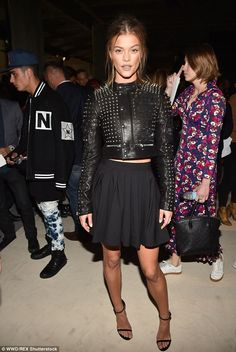 Leather lady: Nina Agdal also attended the event blending a feminine dress with a tough moto jacket