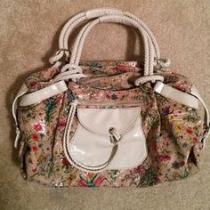 ****extreme discount****Floral tote Need to clean out my closet!!!Super cute only used a few times! Perfect for winter or fall!  Multiple compartments and pockets on the inside and out. No rips or tears Bags Totes