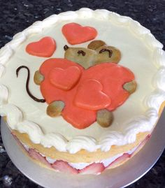 Strawberry cake with fresh cream. Mouse drawing is colored cake batter that has been baked.