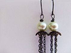 white pearl with long gunmetal chain strands by PaleRoom on Etsy, $27.00