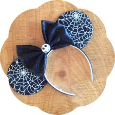 I just bought these amazingly cute Minnie Mouse ears from mouseCAeaes! They have many other amazing ear creations! Check them out! :) https://www.etsy.com/listing/190414425/glow-in-the-dark-jack-skellington-mouse