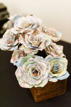 map paper flowers / http://www.deerpearlflowers.com/travel-themed-wedding-ideas-youll-want-to-steal/