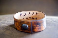 Secret message leather cuff featuring a plain vintage style finish leather on the outside with a custom love note secret message on the inside