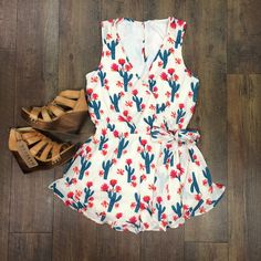 This cactus print craze has taken over SB & the SB Babes, we love it all! This wrap front, ruffle trim romper is so cute & flattering it's unreal!