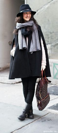 Black hat, black cape, double scarf, white sweater, white gloves, brown boots / Garance Doré