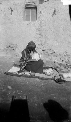 Nampeyo All near Adobe House, Potter(Hopi Tewa) in Native Dress n.d by William Henry Jackson