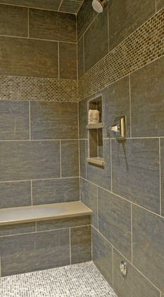 I am not crazy about the tile color but I do love the design with this shower. Something to think about for guest bath.