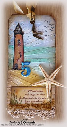 Like the embossing folder base with the lighthouse.  The tag is stunning!