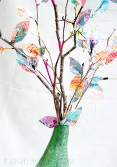 alisaburke: paper leaves....use the kid's art and create paper leaves and stick in a vase. Love how she painted the sticks too (great for dining room table)