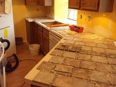 tile over laminate counter tops? What an inexpensive way to cover up the stains and burns on the kitchen counters that where here when we bought the house!