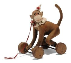 A STEIFF FELT CIRCUS MONKEY ON