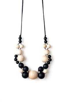 Our Winifred teething necklace features an assortment of smooth black silicone beads, made with BPA-free food-grade silicone with no nasties, perfect for little teeth to sink into. These are interwoven with smooth untreated wooden beads. Our necklaces are high contrast, providing lots of sensory stimulation with alternating textures and movement — perfect for catching the …