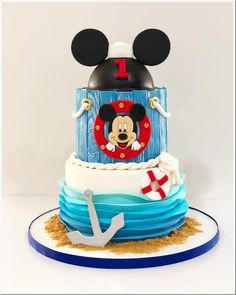 This wonderful Sailor Mickey Mouse Birthday Cake was made by Sweet Brantley Cakes. This is such a beautiful cake. This is a three layer cake. The top layer is carved to look like Mickey Mouse ears. Cake Pops Mickey Mouse, Mickey Mouse Cake Decorations, Mickey Mouse First Birthday, Mickey Mouse Baby Shower, Mickey Cakes, Minnie Mouse Cake, Nautical Birthday Cakes, Boys 1st Birthday Cake, Nautical Mickey