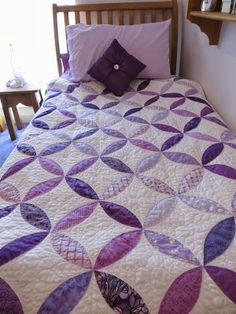 machinequilter - purple pumpkin seed on the bed