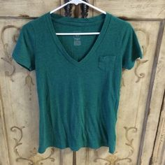Mossimo Boyfriend Tee Light weight/thin  cotton vee neck tee. Has tiny pocket. Has been well loved. Some piling due to washing. Super comfy shirt. Mossimo Supply Co. Tops Tees - Short Sleeve