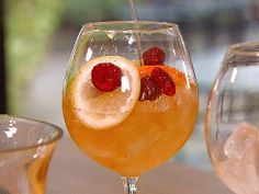 Receta Sangría de Parcha (Passion fruit sangria)    1 sliced orange  1 sliced apple  1 guart light pink or white wine  3 oz cognac  3 tbsp sugar  1 quart passion fruit juice    YUM