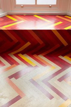 colorful-graphic-interiors-featuring-bright-herringbone-floors-12.jpg