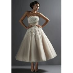 """A Line Tea Length Wedding Dress.  So cute and very vintage...does this still say """"bride"""" though?"""