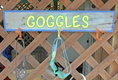 Awesome pool storage ideas - goggle holder from weathered wood and hooks