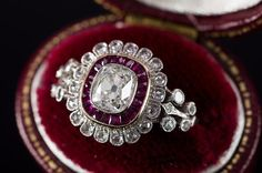 OLD CUSHION CUT DIAMOND AND RUBY HALO RING
