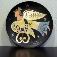 Midcentury Georges Briard Toleware  Angel Metal Plate hand painted, signed. 19.00, via Etsy.