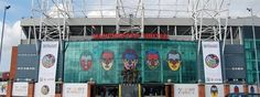 Craig Redman's unique portraits of Wayne Rooney, Javier Hernandez, Rio Ferdinand, Nani and Ryan Giggs at Old Trafford's East Stand entrance.