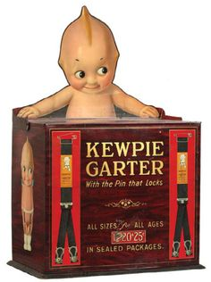 Kewpie Garters Display |  great early tin litho countertop display case w/ wonderful hinged die-cut at top of Kewpie doll character.