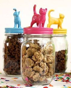 Repurpose old jars! All of those useful jars you have stashed in the cabinet? They would make fantastic treat jars! What you need: Jars with lids, small plastic animals (any kind will do, we recommend either a visit to the dollar store for a bag of toy animals or raid your kid's toy box for some that won't be missed), spray paint of your choice, craft glue, pet treats to put in the jars. To make it extra fancy, tie a ribbon around the top.