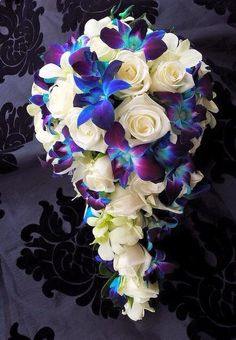 My bouquet will look similar to this for sure. White Roses and Blue Orchids - Makayla McShan Blue Orchid Bouquet, Blue Orchid Wedding, White Rose Bouquet, Purple Orchids, White Roses, Cascading Wedding Bouquets, Cascade Bouquet, Bride Bouquets, Bridal Flowers