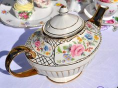 Gold and floral design vintage Arthur Wood teapot.