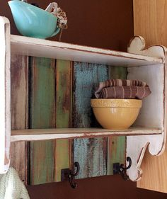 Pretty shelf for the kitchen made out of old fence posts, scrap wood, and hooks.