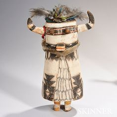 Hopi Carved Wood Kachina Doll, representing Shalako Kachina, the case mask with horns, square snout, and popeyes, fur collar, and painted detail overall, (minor wood loss), ht. 15 1/2 in.