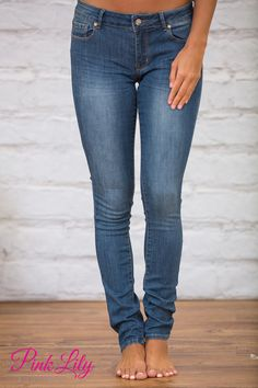 These classic skinny jeans are simply a must-have this season! Featuring a beautiful medium wash denim, these jeans are easy to pair with a variety of blouses and sweaters for a gorgeous look!
