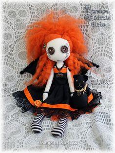 A Halloween themed custom button eyed doll in orange and black.  #halloween #buttoneyedoll #orangeandblack #gothicdoll