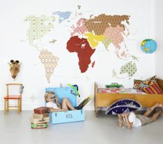 I'm pretty much in love with this wallpaper patterned map of the world on the wall <3