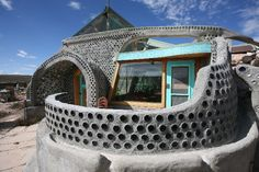 completely self-sustaining homes designed by architect Michael Reynolds. There's a whole community of progressive folks living out there completely off-the-grid. Their homes are made of recycled materials like mud-packed tires and bottles, and each home generates its own power and collects its own water. MINE