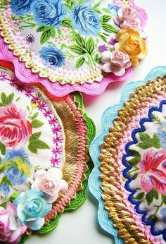 Brooches made from vintage scarves, ric-rac and other findings. These would make great coasters!