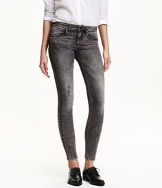 Dark grey, low-rise jeans in washed super-stretch twill with heavily distressed details, ultra-slim legs, mock pockets at front, and regular pockets at back. | H&M Denim